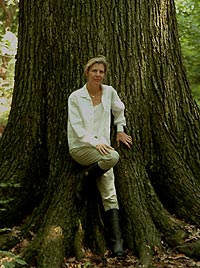 image, Joan Maloof next to old growth tree.