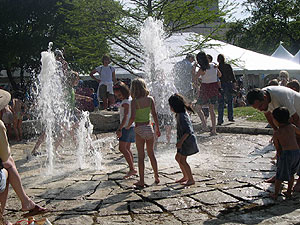 Children playing the in Republic Square fountain during the 2006 Austin Fine Arts Festival.