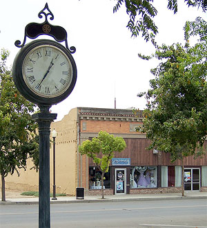 Downtown Corcoran: corner clock and street retail.