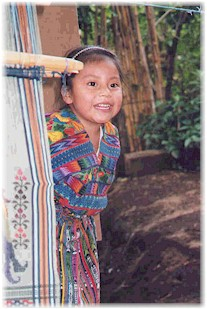 A young Maya girl displays her family's weaving skills.