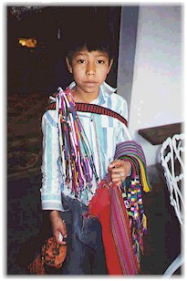 A young Maya boy selling tipica.