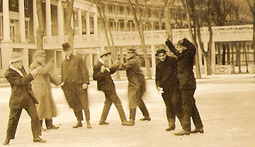 Real picture postcard: Young men in winter, hand-dated February 22, 1910.