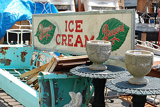 Items for auction: Breyer's ice cream sign, tables, pots, and more.
