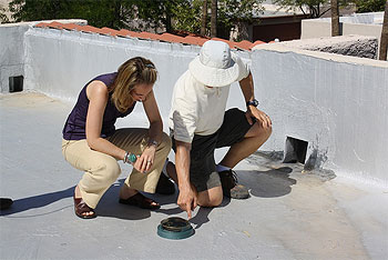 Rep. Giffords on rooftop with consultant.