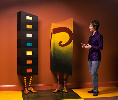 Furnituremaker Meg Romero with her artful cabinets,  award-winning Rupert and his sidekick Roxy.