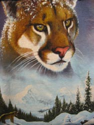 Painting of mountain lion and winter landscape.