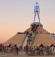 Burning man at dusk.
