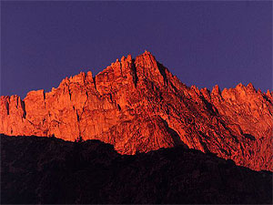 Red mountain ridge at sunset.