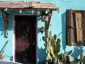 Barrio home with turquoise walls.
