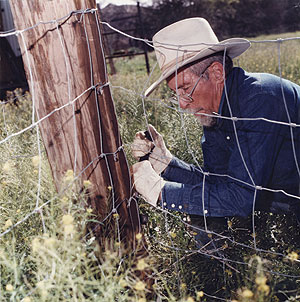 Jim Corbett working on fence.