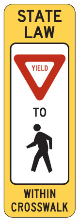 Sign: State Law: Yield to pedestrians within crosswalk
