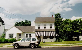The Updike house, complete with silver SUV.