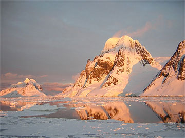 Warm light on mountains in Antarctica. Photo by Lucy Jane Bledsoe..