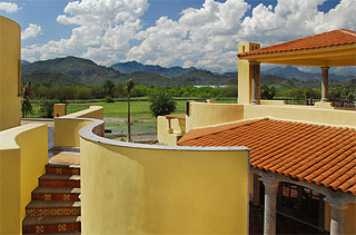 View of golf course and Sierra de la Giganta mountains from a custom home in the Founders' Neighborhood.