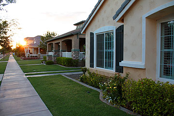 Classic homes have no alleys but place the garage to the rear of the lot, accessible by strip driveways.