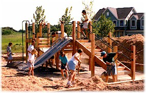 Neighbors working on playground structure.