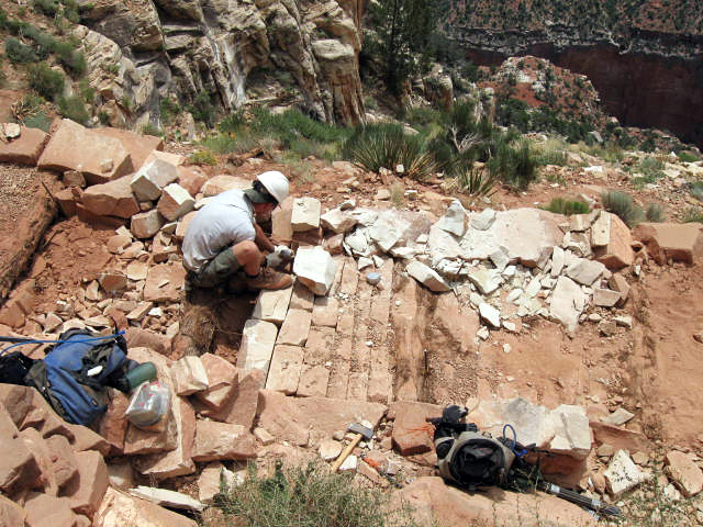 trail-crew-member-constructing-rip-rap-on-the-south-kaibab-trail