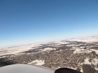 A view of suburban Fargo, North Dakota, during a winter flight. Photo by W. Scott Olsen.