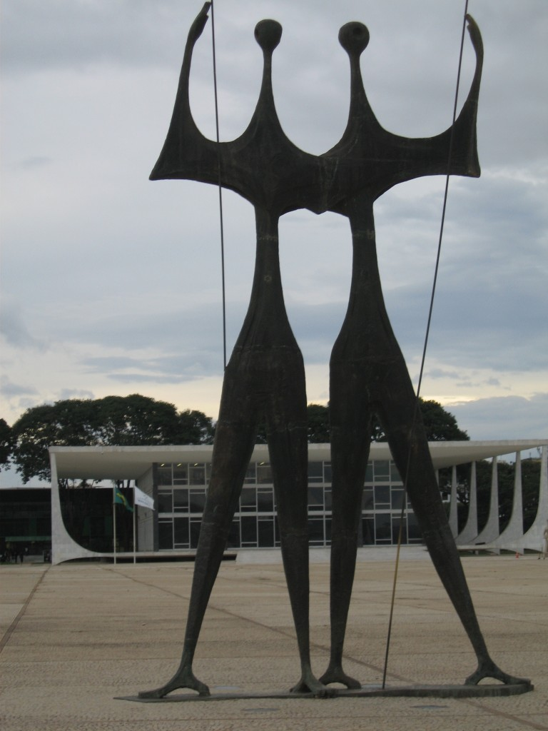 """Os Candanos"" to the workers who built Brasilia by Bruno Giorgio; Niemeyer High Court in background."