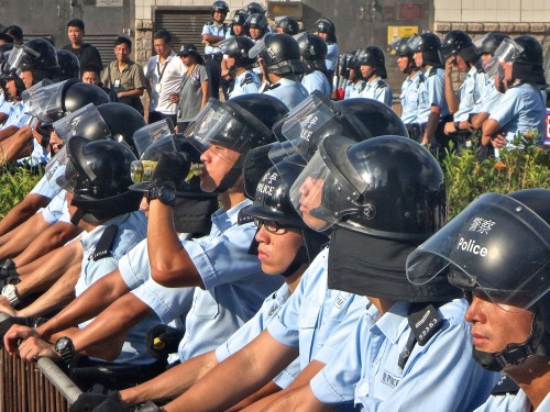 The front-line police look almost as young as the student demonstrators.  In the early tenser days the sun made everyone hot, but the officers seemed more stressed than the protestors.