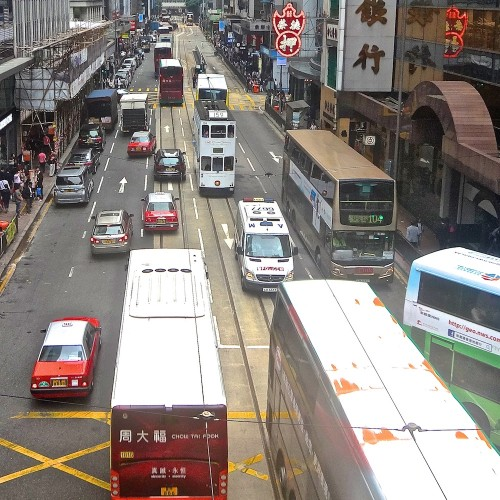 A relatively light traffic time on Des Voeux Road Central.
