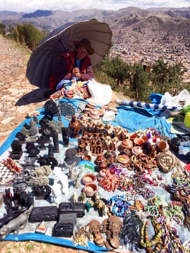 A Bolivian woman sells souvenirs over La Paz.