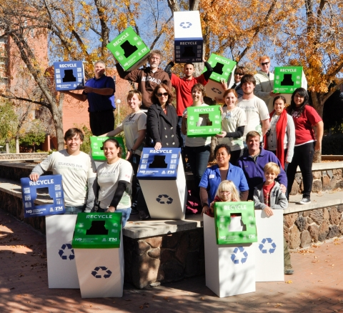 UA students with recycling bins