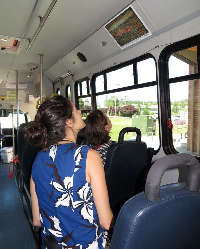 Admiring a poetry broadside on the city bus in Moscow, Idaho. Photo courtesy Elizabeth Bradfield.