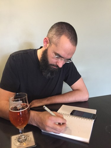 Architect Matthew sketches an idea at a local craft brewery