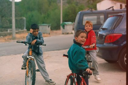 Mario and his brother and friend riding bikes as children