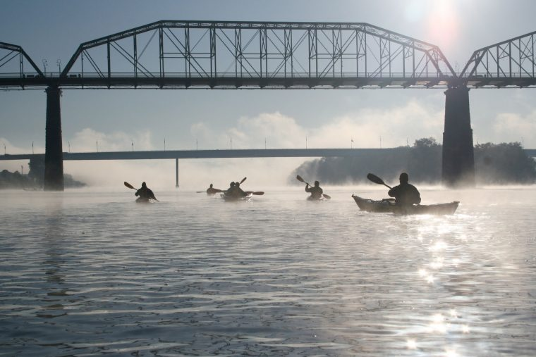 Paddlers under Walnut Street Bridge in Chattanooga. Photo courtesy Chattanooga Convention & Visitors Bureau.