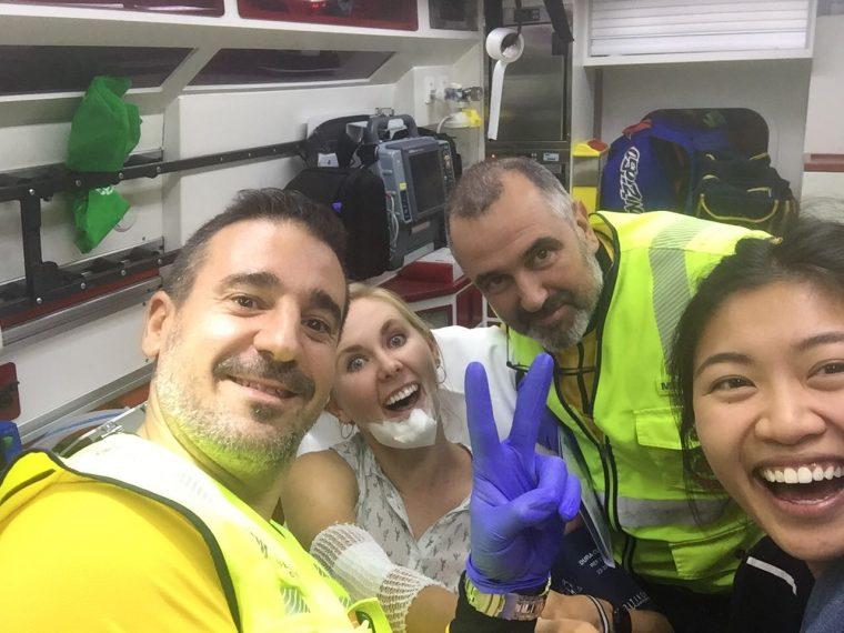 Zoe, her friend, and two ambulance men