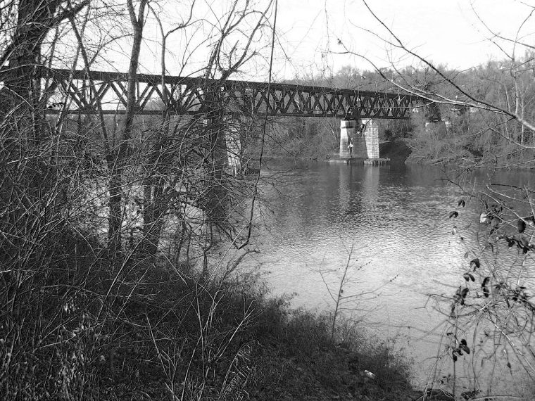 Burlington Northern railroad trestles spanning the Meramac River. Photo by Jennie Goode.