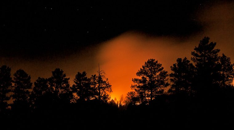 Thompson Ridge wildfire burns through the night
