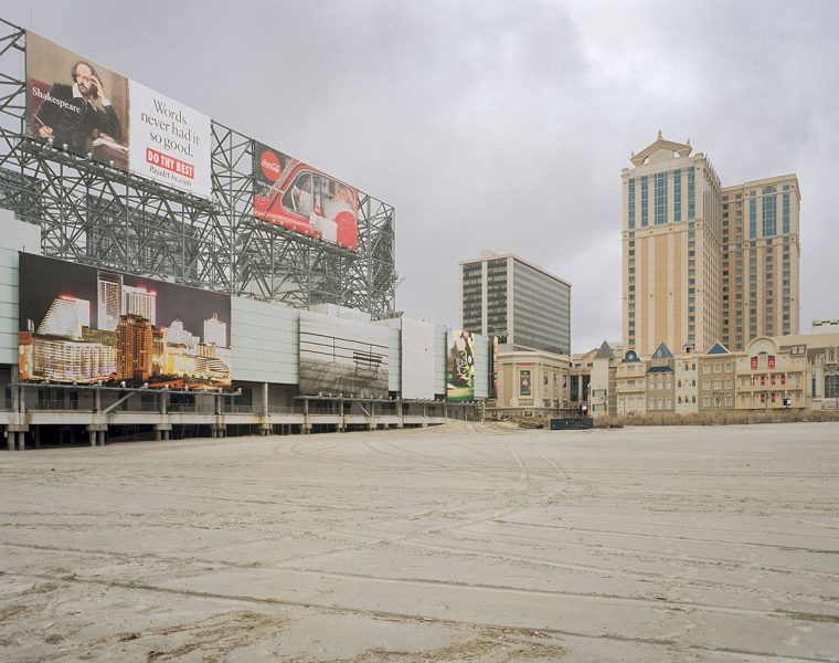 Empty parking lot, casino, and billboards in Atlantic City
