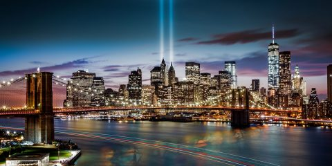 New York City skyline with 9/11 Memorial lights at night