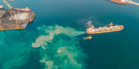 Aerial view of cargo ship leaving port